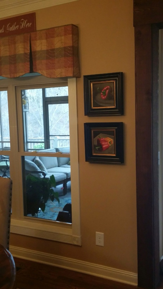 Framed 8x8 bell pepper paintings in Linda's home
