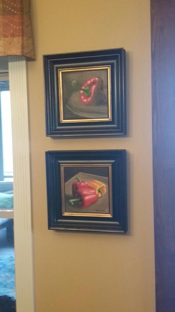Framed 8x8 bell pepper paintings in Linda's home