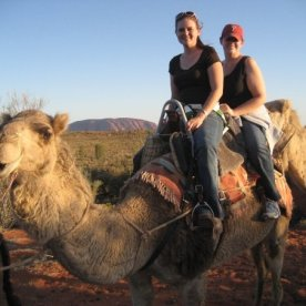 Jennifer and I on our camel tour with Uluru in the background